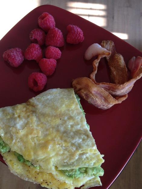Whole30 Breakfast: Bacon, Avocado Omelette, Raspberries